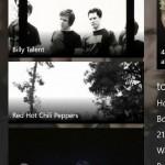 ภาพถ่ายหน้าจอแสดงรายชื่อศิลปินซึ่งมีแนวดนตรีคล้ายคลึงกันบนวินโดวส์โฟน 8